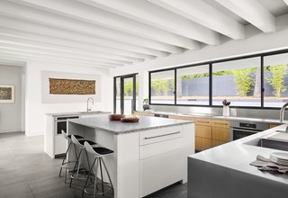 The spacious kitchen has smart, built-in storage and serving-windows set at countertop-height, which open out onto the pool terrace and entertaining area.