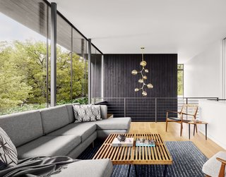 Wrapped in frameless glass set atop a continuous planter wall, the upper level looks out to the trees and beyond.
