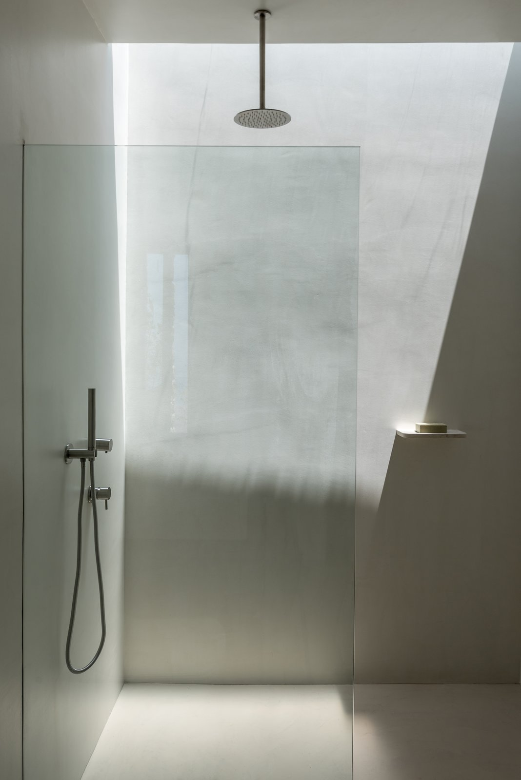 Bath Room, Concrete Wall, Open Shower, and Concrete Floor The two bathrooms are located on either end of the rectangular plan, and are fitted with discrete skylights for additional illumination.  Best Photos from CASA