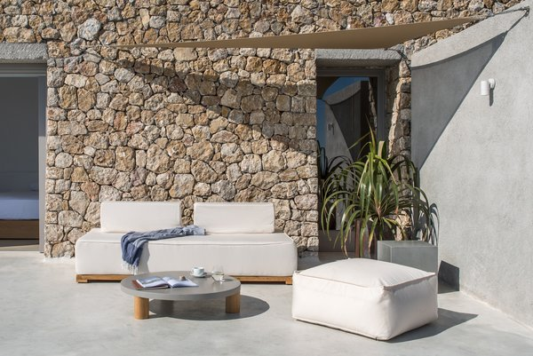 Outdoor, Small, Front Yard, Boulders, Concrete, Concrete, Hanging, and Stone The outdoor terrace features an infinity pool and spacious deck.   Best Outdoor Boulders Hanging Photos from A Modern Home Is Gently Slotted Into a Steep Slope in Santorini