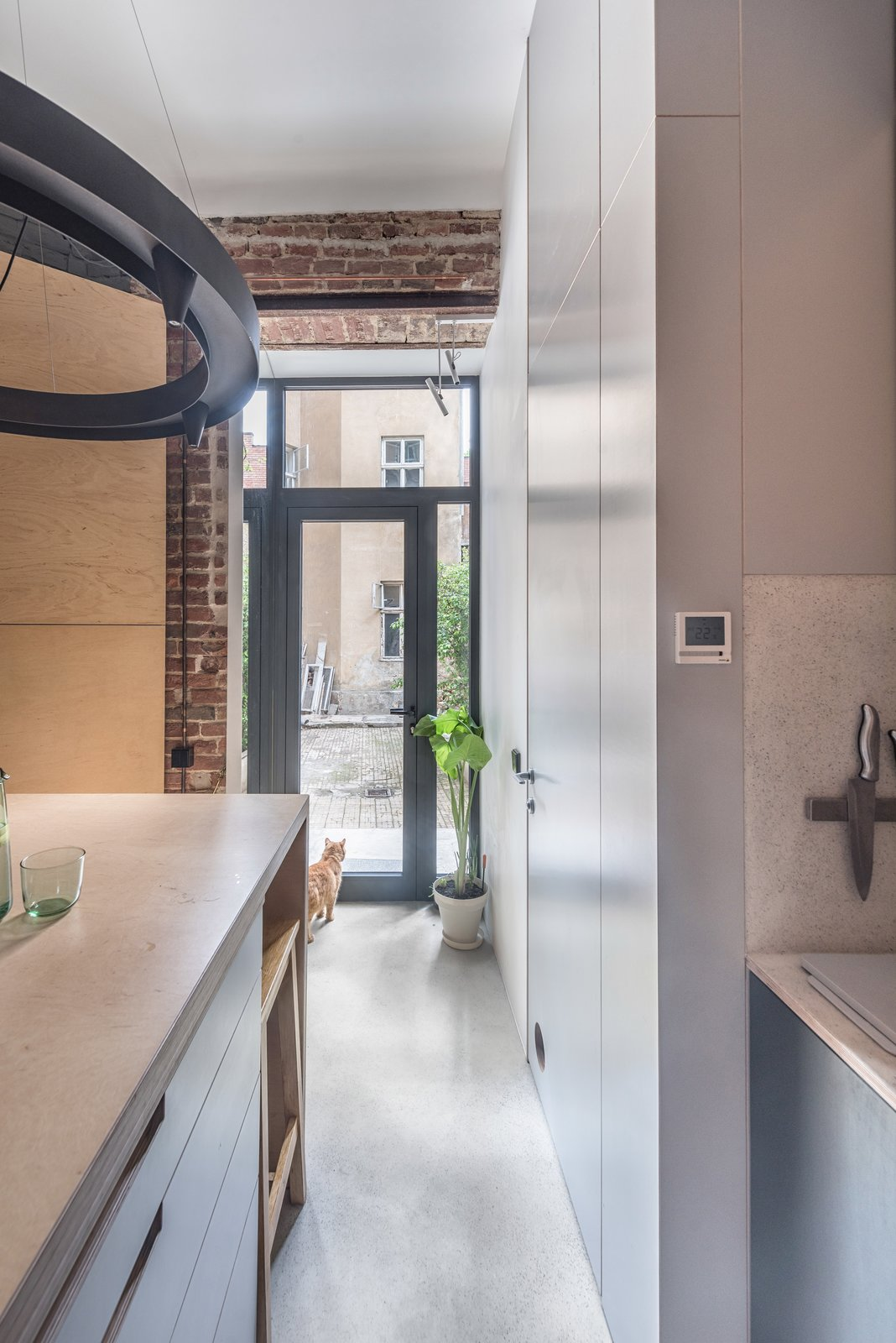 """Kitchen and Wood Counter According to Badzyan Khrystyna, one of the studio's lead architects, """"the apartment embodies the rhythm and lifestyle of its owners.""""     Photo 14 of 16 in Before & After: A Little Flat in Ukraine Gets a Modern Upgrade"""