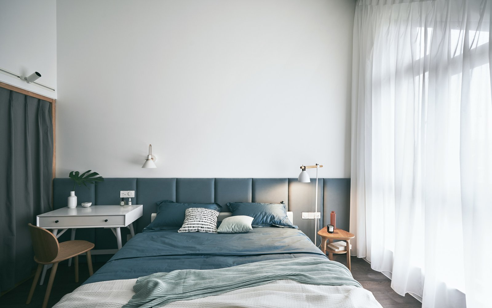 Bedroom, Bed, Chair, Wall, Floor, Night Stands, and Medium Hardwood The choice of colors and materials work together to create a bright, cheerful, and romantic atmosphere.    Bedroom Medium Hardwood Floor Wall Photos from A Loft Mezzanine Cleverly Enlarges This Small Beijing Flat