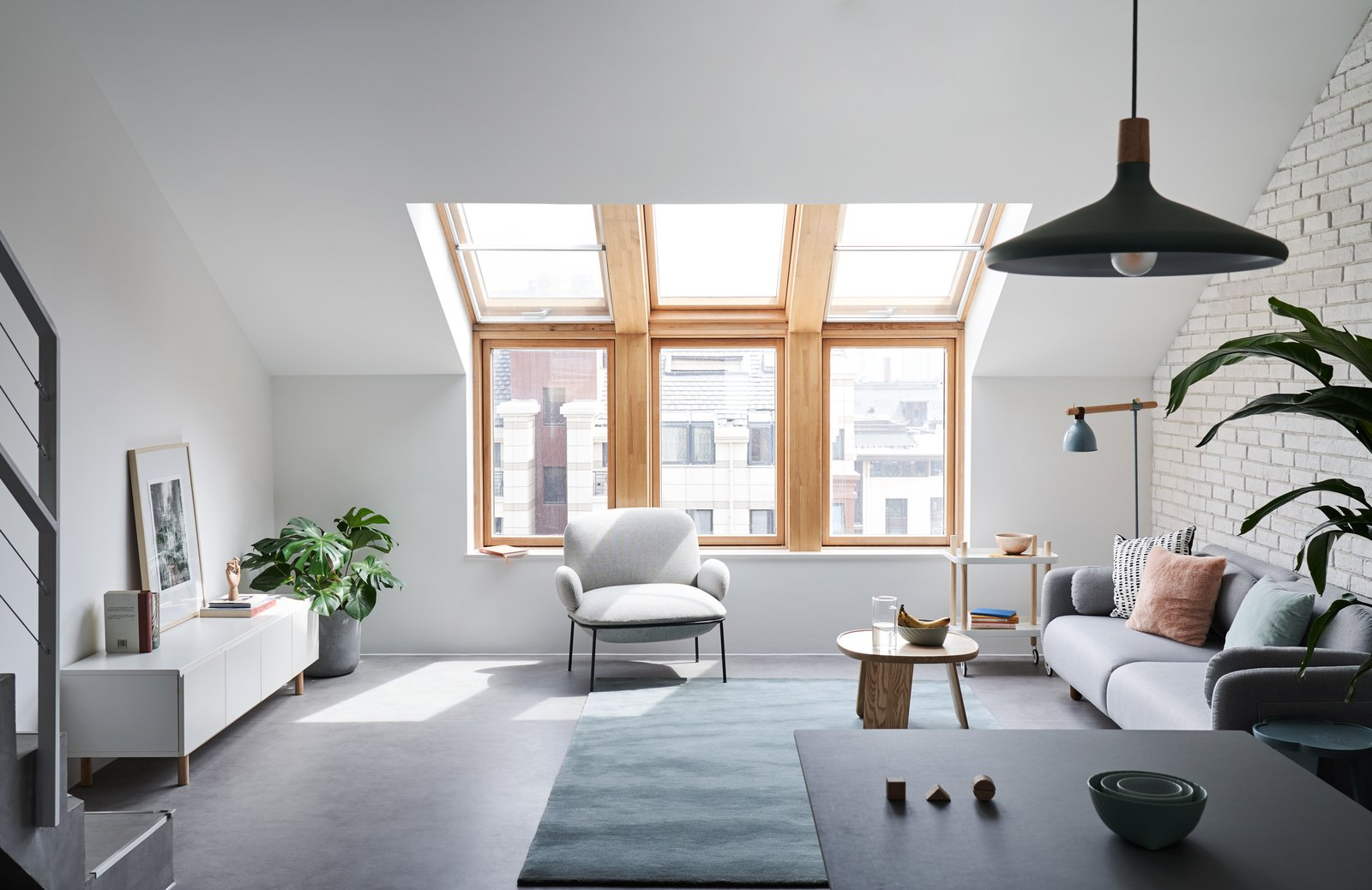 Living Room, Console Tables, Coffee Tables, Floor Lighting, Pendant Lighting, Table, Sofa, Chair, Rug Floor, and Concrete Floor A light gray sofa sits in the living lounge.    Best Photos from A Loft Mezzanine Cleverly Enlarges This Small Beijing Flat