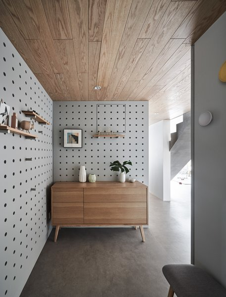 An entryway with perforated walls.