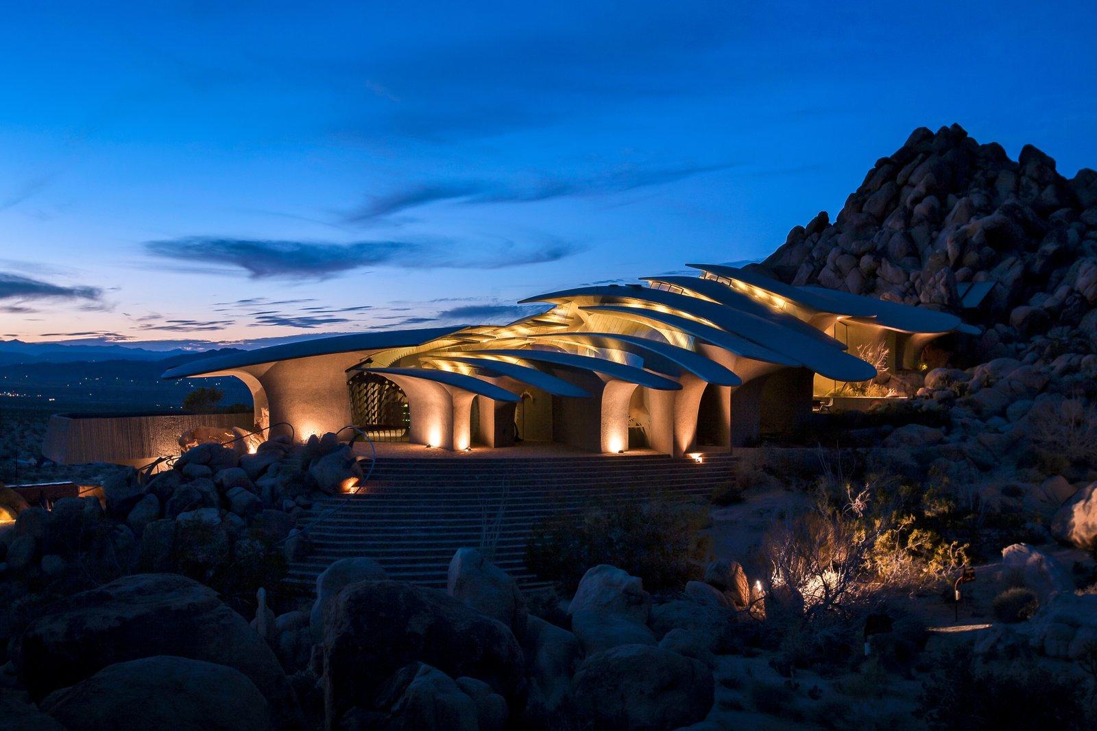 High Desert House exterior at night.
