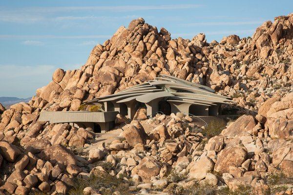 Comprised of 26 freestanding, concrete columns that look like rib bones, the High Desert House sits incognito among the lunar-like landscape in Joshua Tree, California.