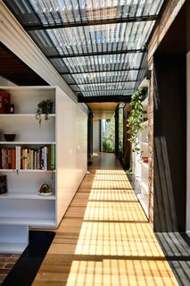 With the entry relocated, the original terrace entrance porch was transformed into a garden, and the entry corridor was repurposed as a bathroom.
