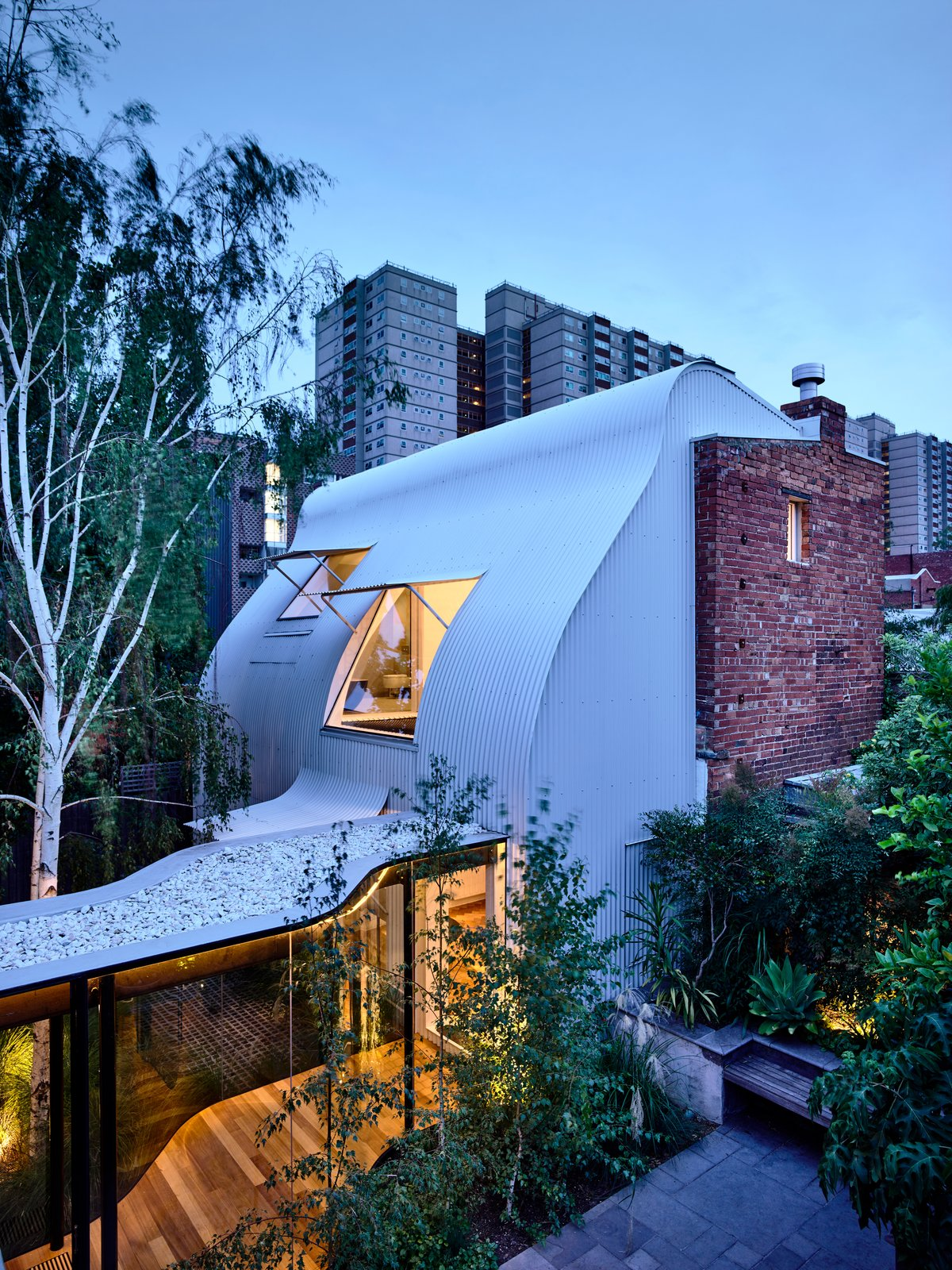 Exterior, Brick Siding Material, Metal Siding Material, Metal Roof Material, and House Building Type Respecting the site's heritage, the architects retain the house's terrace façade.  Photo 2 of 19 in An Inventive Melbourne Remodel Greets the Street With a New Garden