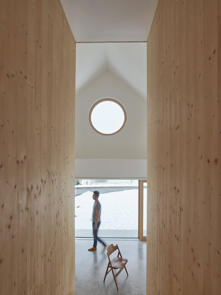 A basic material of pale timber walls, polished concrete floors, and large expanses of glass work together to create a calm, light aesthetic.