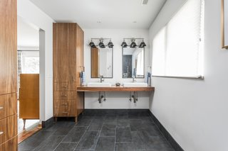 """""""Our bathroom cabinets were really the biggest success for us. With all the medical supplies, we needed extra storage in the bathroom. We had a very specific vision in mind, which Duvall Woodworking knocked out of the park,"""" says LeAnne."""