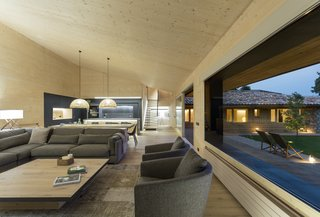Large expanses of glazing visually connect the living room with the garden.