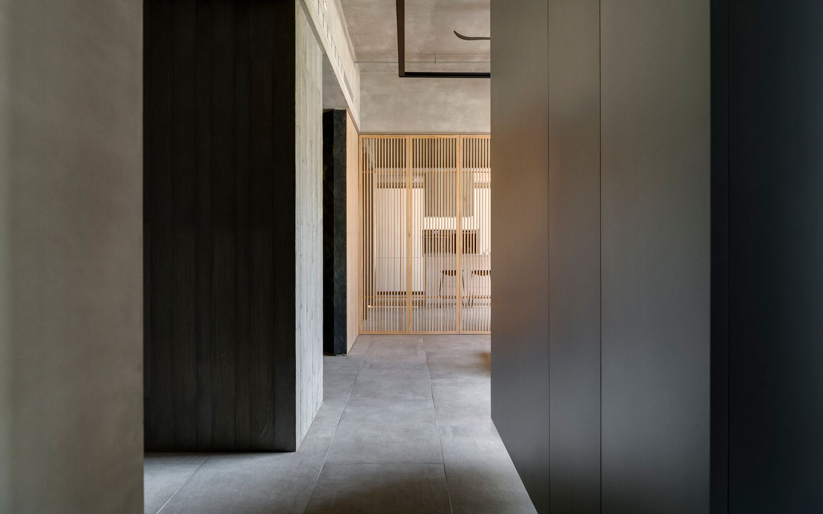 Hallway and Concrete Floor Concrete and warm wood merge together to create a tranquil setting throughout the home.     Photo 10 of 16 in A Couple Embrace Wabi-Sabi Design to Travel Back to the Past