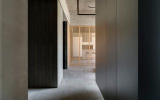 Concrete and warm wood merge together to create a tranquil setting throughout the home.