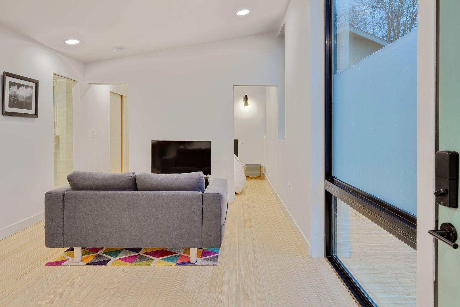 Living Room, Sofa, Light Hardwood Floor, Recessed Lighting, and End Tables The living room in Trillium.  Best Photos from NODE Prefab Homes Aim at a Carbon Negative Future
