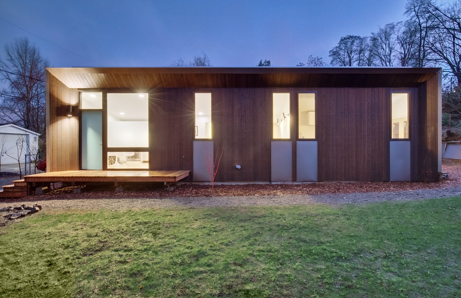 Exterior, Wood, Prefab, Flat, Small Home, and Metal A 669-square-foot, one bedroom, one bedroom guest unit, the Trillium is a zero-net energy house with a large outdoor storage closet.   Best Exterior Metal Wood Small Home Photos from NODE Prefab Homes Aim at a Carbon Negative Future