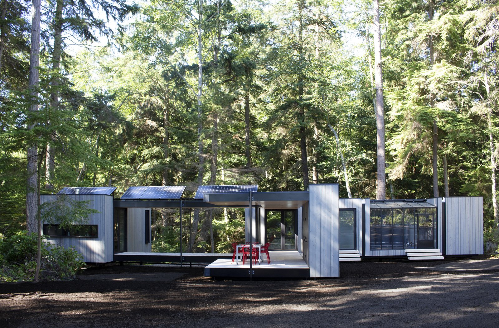 """Exterior, Prefab Building Type, Wood Siding Material, Metal Roof Material, Flat RoofLine, and Small Home Building Type """"Radical sustainability  Photos from NODE Prefab Homes Aim at a Carbon Negative Future"""