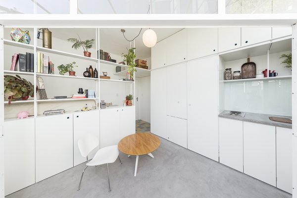 The white kitchen and laundry joinery fold away, making them out of sight when not in use.