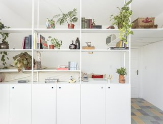 The open shelves separate the more secluded sleeping and study area from the rest of the apartment, yet still allow for strong visual connectivity, as well as ample light flow.