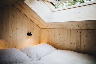 The lofted bedroom features a king-size Casper Mattress, and a skylight window that allows for idyllic stargazing at night.