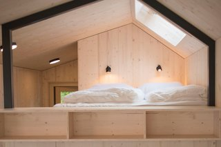 Under the bed platform is a large wardrobe, storage spaces, and a USB docking station.