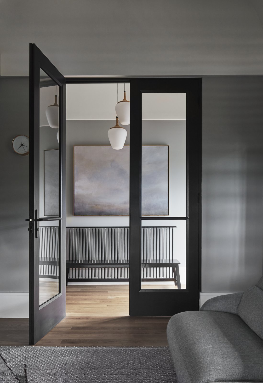 Doors, Metal, Interior, and Swing A glazed link connects the old and new components of the house.  Best Doors Interior Swing Photos from An Old Kit Home Is Transformed Into a Multi-Generational Abode