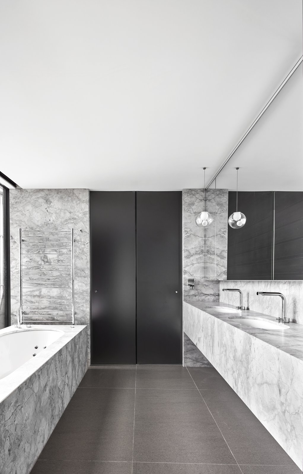 Bath, Soaking, Marble, Undermount, Pendant, Marble, and Drop In A peek at the bathroom finished with plenty of natural stone.  Best Bath Marble Drop In Undermount Soaking Photos from An Old Kit Home Is Transformed Into a Multi-Generational Abode