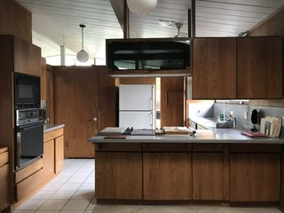 Before: This Eichler home had most of its Lauan wood paneling intact, so interior designer Cathie Hong chose luxury vinyl tiling rather than hardwood flooring.