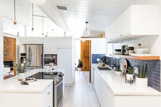 Interior designer Cathie Hong transformed the kitchen of this San Jose Eichler into a bright open space, but kept the wood paneling in the adjacent room, to preserve the warm, midcentury feel.