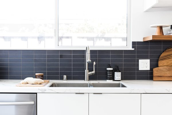 Though the homeowner had a strong preference for a blue backsplash, Hong feared the shade would disrupt the midcentury feel. As a compromise, she opted for a subtle, earthy slate blue in a cool matte finish.