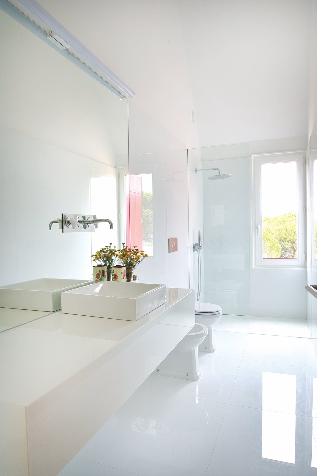 Bath, Vessel, One Piece, Full, Enclosed, Engineered Quartz, Marble, and Wall A bright and white bathroom.  Best Bath One Piece Vessel Enclosed Full Wall Photos from A Fiery-Red Home Sizzles With Simplistic, Modern Design
