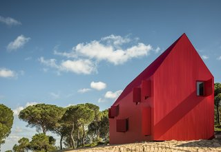 The 4,356-square-foot House 3000 was conceived as a simple child's drawing of a gable-roofed house with clean, sharp outlines, and simple doors and windows. Architect Luis Rebelo de Andrade compares the dwelling's form to the homes of the first settlers in the American West.
