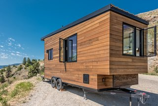 The exterior is clad in a mixture of stained cedar and shou sugi ban siding.