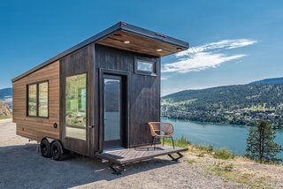Designed and built by Oliver Stankiewicz and Cera Bollo—the husband-and-wife team of Canadian tiny home builder Summit Tiny Homes—this 22-foot-long, 175-square-foot contemporary tiny home called The Wanderer was built with mobility and adventure in mind. Constructed with an aerodynamic roofline, the home also features a compact, fold-down deck that's convenient for traveling. The stylish exterior is clad in a mixture of stained cedar and shou sugi ban siding. This model is available for $53,780.