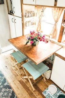 The kitchen table is a maple butcher block from a farmhouse in Old Orchard Beach in Maine.