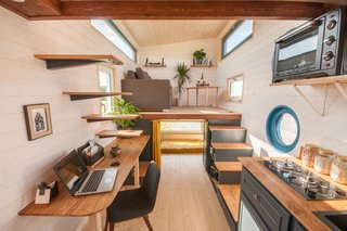 Tiny House Valhalla, designed by Baluchon, features floating steps that lead to a sleeping loft.