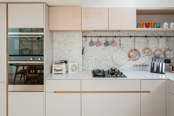 Marble And Mosaic Tiles Are Used For The Simple Minimalistic Kitchen Which Includes A