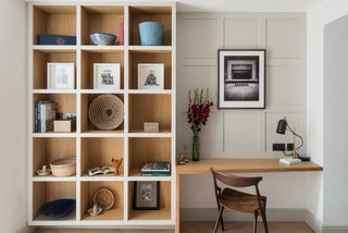 A study boasts built-in shelves for books or decorative vignettes.