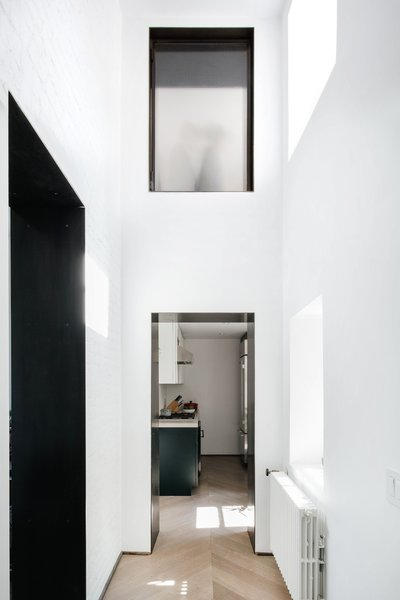 While the apartment's floor area is modest, its high walls give the space a lofty, voluminous feel.