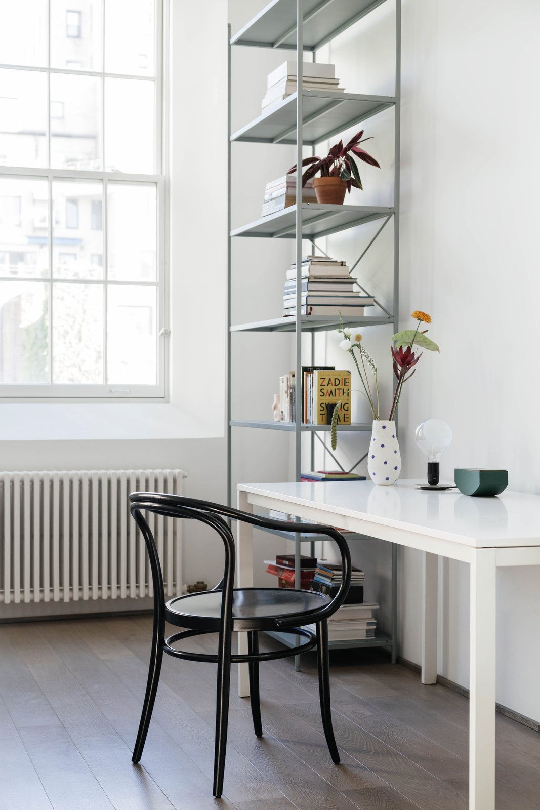 Office, Bookcase, Shelves, Chair, Desk, Study Room Type, and Medium Hardwood Floor A bookshelf from Ferm Living.  My Photos from A Small Manhattan Home Gains  Space With Two Cozy Lofts