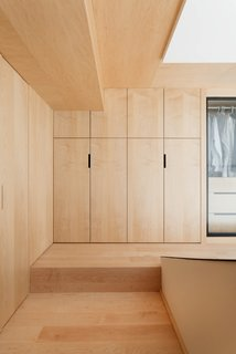 The discreet wooden closet matches the flooring.