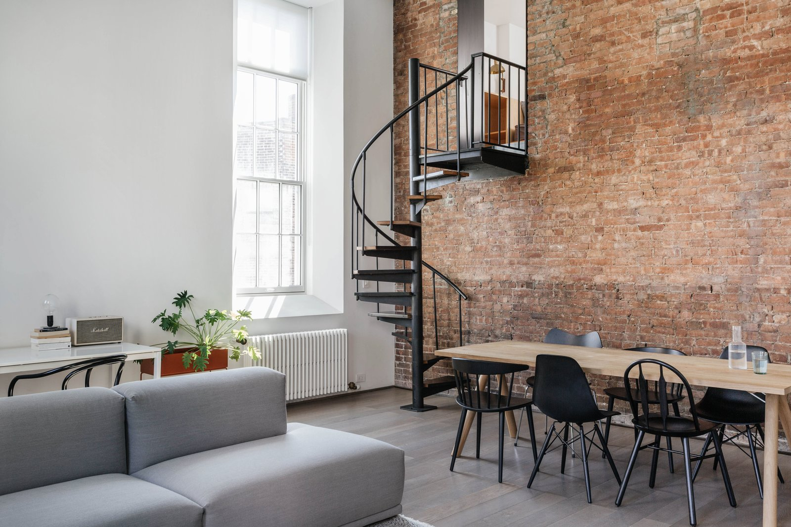 Staircase, Metal Tread, and Metal Railing Chairs from Hay and Matter.  My Photos from A Small Manhattan Home Gains  Space With Two Cozy Lofts