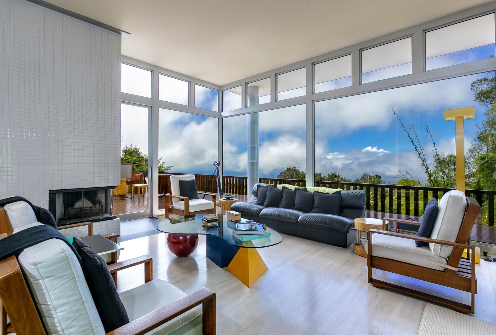 Living, Sofa, Chair, Light Hardwood, Coffee Tables, Corner, Floor, and Lamps The living room encompasses white oakwood floors.    Best Living Corner Chair Photos from A Vibrant, Iconic Home Hits the Market in Hawaii For $9.8M