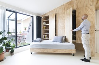 One of the walls hides a pull-out sofa and a wardrobe.