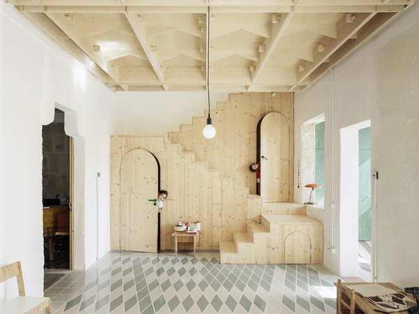 A Luminous Plywood Addition Crowns This Mallorca Townhouse