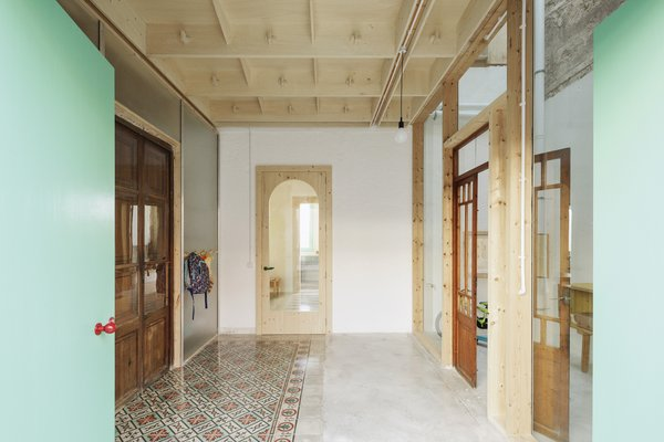 Vibrant tiles from Mallorca concrete tile brand Huguet were used for sections of the floor.