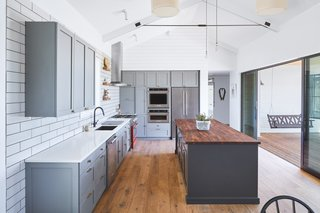 Gray custom cabinetry were created by Shields Custom Carpentry.