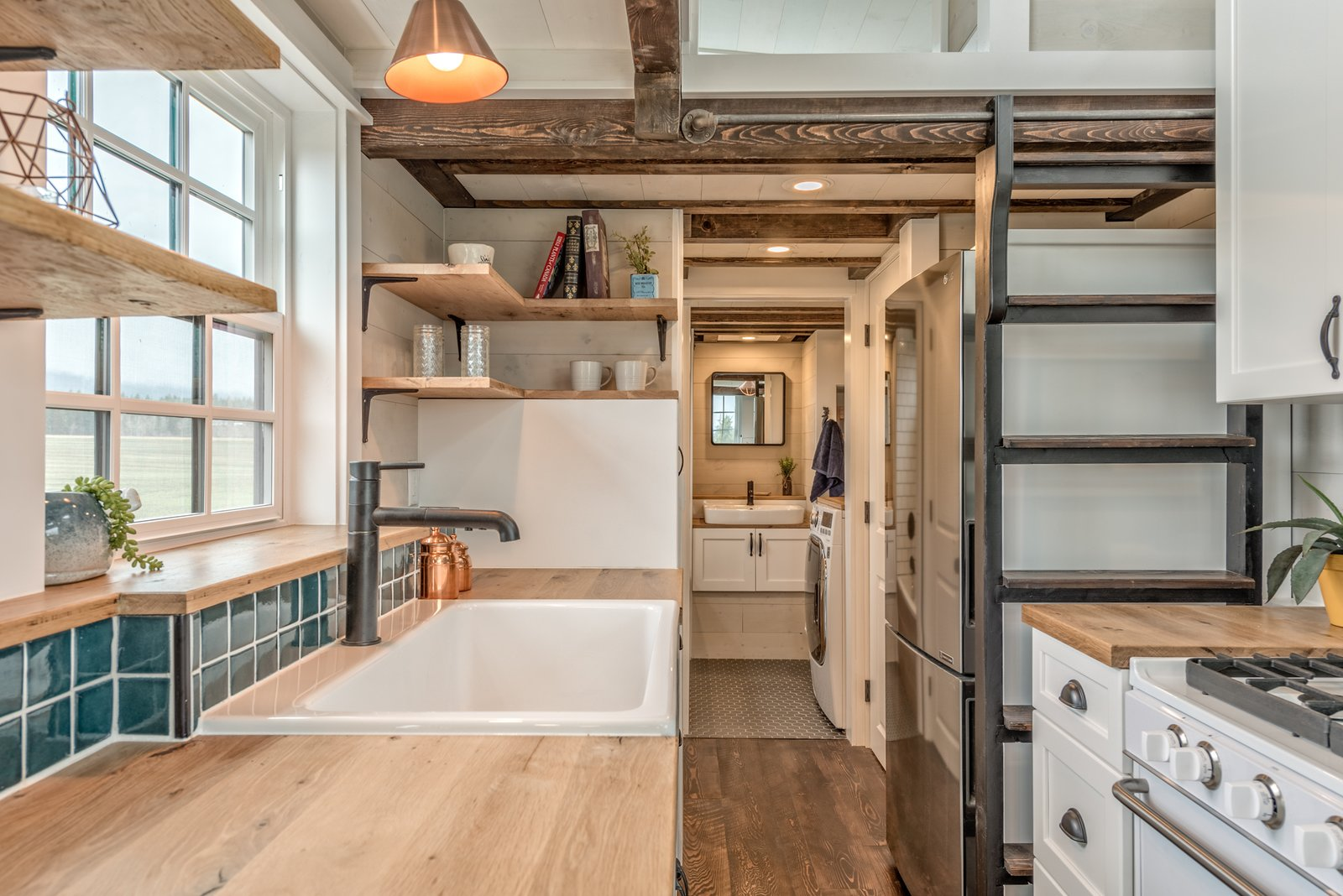 Kitchen, Recessed, Wall Oven, Medium Hardwood, Wood, Ceramic Tile, White, Drop In, and Pendant The ladder to the loft can be slid to the side when not in use.     Best Kitchen Recessed Pendant Wall Oven Wood Photos from This Canadian Tiny Home Beams a Rustic, West Coast Vibe