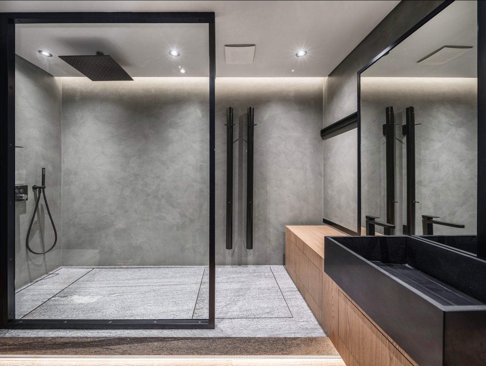 Bath, Vessel, Recessed, Wood, Slate, Open, Enclosed, Full, and Concrete The glass dividers in the bathroom are hand-crafted by Ukrainian craftsmen.  Best Bath Wood Recessed Full Open Photos from A Monochromatic Palette Unifies Old and New in This Ukrainian Bachelor Pad