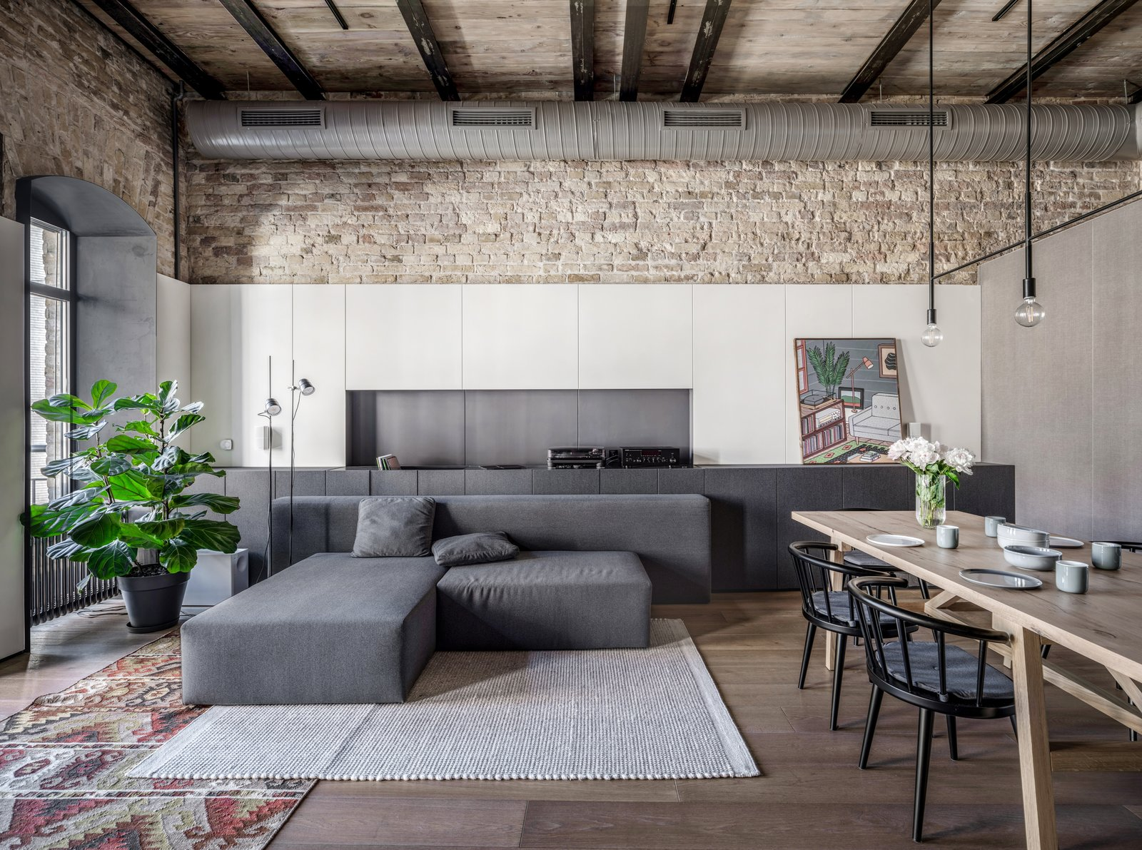 Living Room, Pendant Lighting, Floor Lighting, Medium Hardwood Floor, Storage, Rug Floor, Chair, Lamps, Table, and Sectional Luceplan Counterbalance floor lamp and Ditre Italia sofa.  Best Photos from A Monochromatic Palette Unifies Old and New in This Ukrainian Bachelor Pad