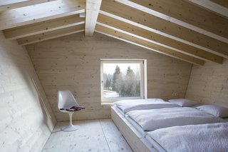 A sleeping space in the upper-level loft.